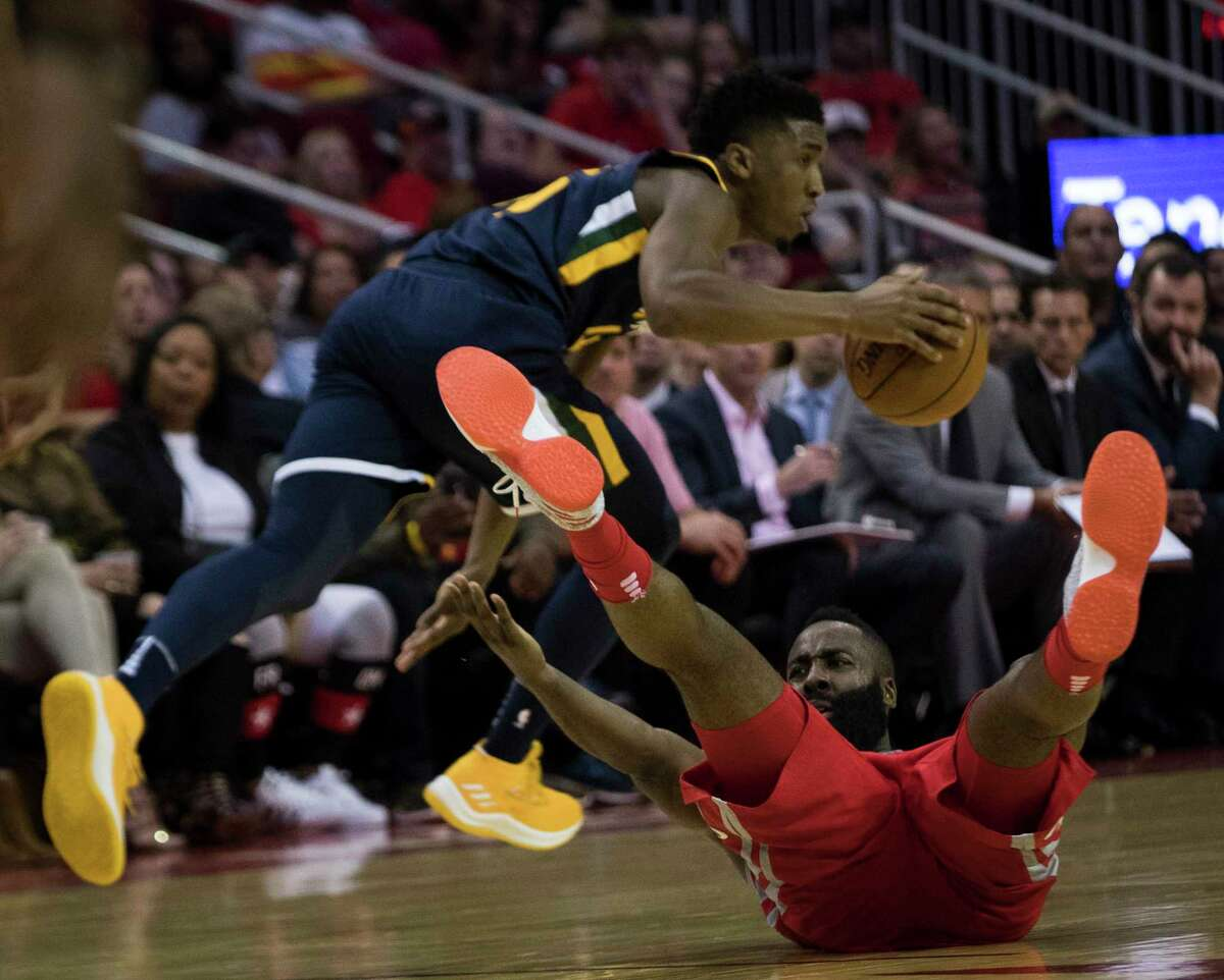 Houston Rockets guard James Harden (13) gets fouled by Utah Jazz guard Donovan Mitchell (45) during the second half on Sunday, Nov. 5, 2017, at the Toyota Center in Houston. The Rockets won 137-110. ( Marie D. De Jesus / Houston Chronicle )
