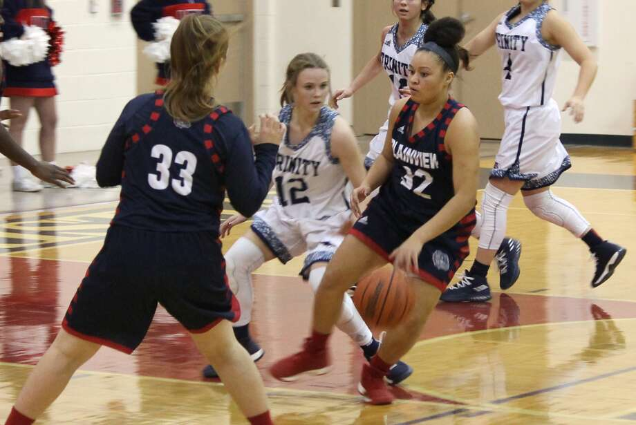Plainview's Taylor Stevenson, 32, dribbles away from Trinity Christian's Jasmine Wadsworth, 12, as Lady Bulldog teammate Kylie Bennett, 33, looks to help out during a game in Lubbock Tuesday night. Photo: Carmen Ortega/Plainview Herald