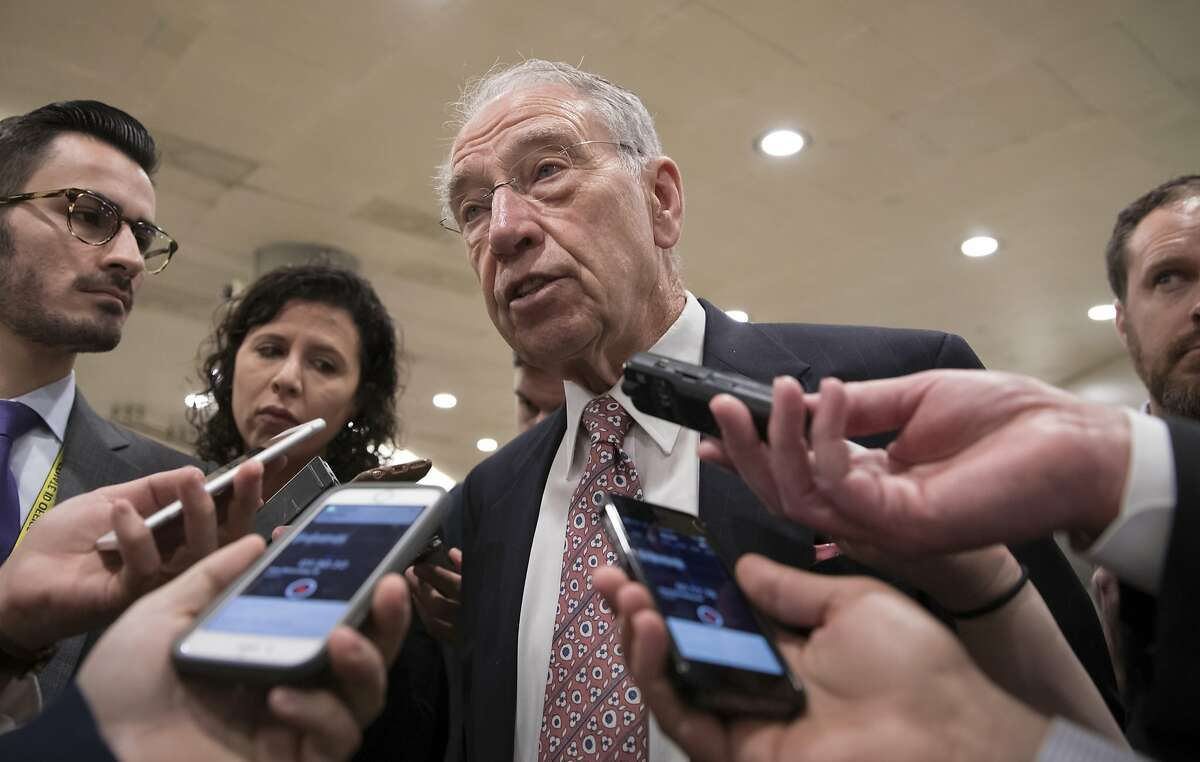 With the deadline looming to pass a spending bill to fund the government by week's end, Senate Judiciary Committee Chairman Chuck Grassley, R-Iowa, and other senators gather for weekly strategy meetings on Capitol Hill in Washington, Tuesday, Dec. 5, 2017. (AP Photo/J. Scott Applewhite)