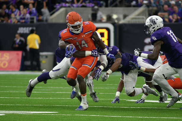 Sam Houston State junior wide receiver Davion Davis (14) tries to break free of a Stephen F. Austin defender during their Battle of the Piney Woods clash at NRG Stadium in Houston on Saturday, Oct. 7, 2017. (Photo by Jerry Baker/Freelance)
