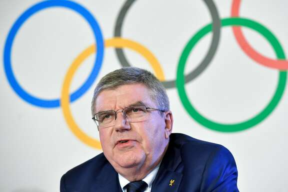"""International Olympic Committee (IOC) President Thomas Bach speaks during a press conference closing an IOC executive meeting on December 6, 2017 in Lausanne. Analysts praised the International Olympic Committee on December 6 for being """"brave"""" and """"strong"""" in banning Russia from the 2018 Winter Games in South Korea. Although Russian athletes will be allowed to compete in Pyeongchang under the Olympic flag, and under strict conditions, the move to exclude a country over doping by the IOC on Tuesday was unprecedented. / AFP PHOTO / Fabrice COFFRINIFABRICE COFFRINI/AFP/Getty Images"""