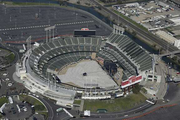 FILE - This Feb. 5, 2016, file photo shows the Oakland�Alameda County Coliseum, home to the Oakland Athletics, in Oakland, Calif. The Athletics are left to consider yet another site to build a new ballpark after the team's top choice of location near Laney College fell through with the board of Peralta Community College District. A's President Dave Kaval and his team had considered this the top spot and had engaged in conversations with community members, officials and business owners in the area in hopes of building a privately financed ballpark to open as soon as 2023. (AP Photo/Eric Risberg, File)