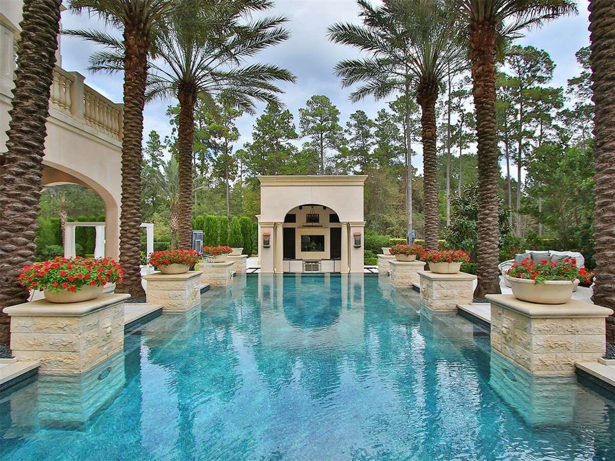 A 9,024 square-foot mansion in The Woodlands featuring six bedrooms, nine full bathrooms and a theater room is on the market for $3.9 million.
