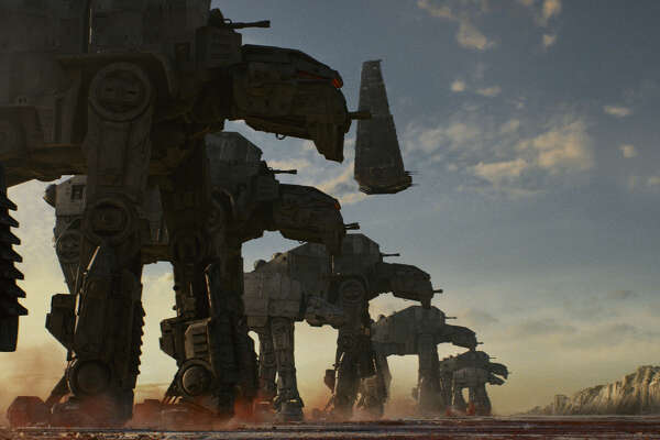 """AT-M6 walkers, along with Kylo's shuttle in a still image from """"Star Wars: The Last Jedi."""""""