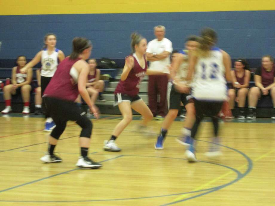 Torrington, in red shirts, is rebuilding in NVL girls basketball; Gilbert is a contender in the Berkshire League Photo: Peter Wallace / For Hearst Connecticut Media