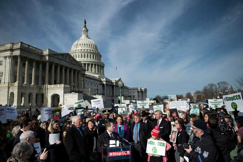 People gather during an event on Capitol Hill opposing concealed carrying of guns December 6, 2017 in Washington, DC. US lawmakers were expected to vote Wednesday to let gun owners carry concealed firearms across state lines, a controversial bill that critics say is aimed at undermining national gun control efforts. Photo: Brendan Smialowski / AFP /Getty Images / AFP or licensors