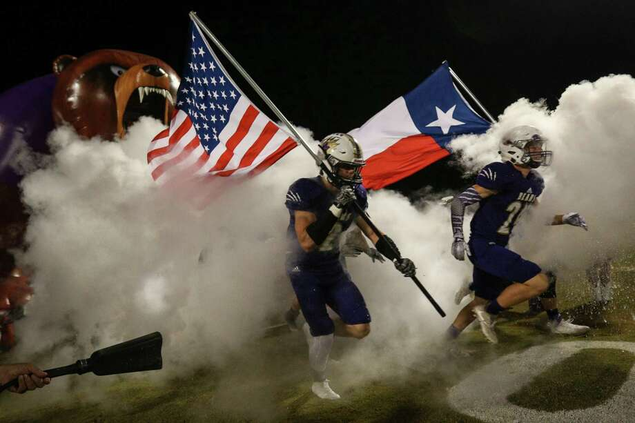 The Montgomery Bears take the field during the varsity football game against The Woodlands on Friday, Nov. 3, 2017, at Bears Stadium in Montgomery. (Michael Minasi / Houston Chronicle) Photo: Michael Minasi, Staff Photographer / © 2017 Houston Chronicle