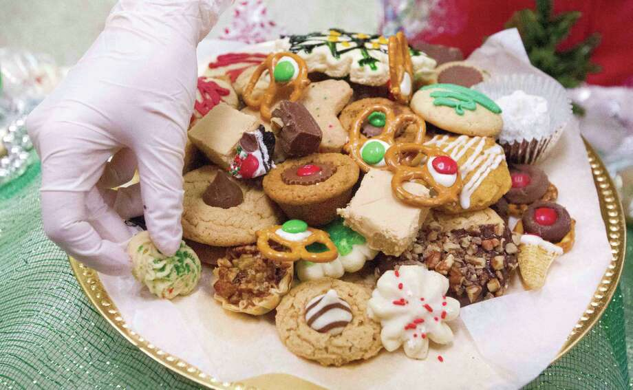 Malerie Dozier sorts cookies before the annual Cookie Walk Saturday, Dec. 12, 2015,  in Montgomery. Photo: Jason Fochtman / Internal