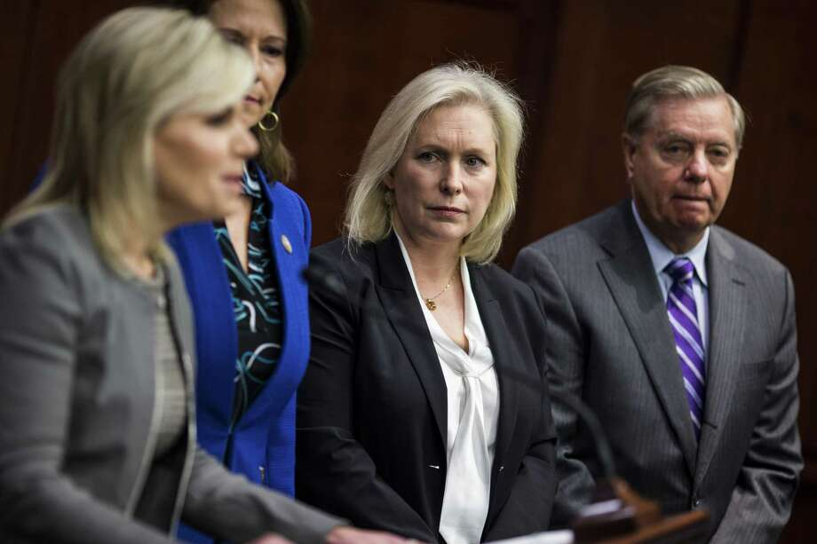 Senator Kirsten Gillibrand, (D-N.Y.) center, was the first to call for Sen. Al Franken's resignation on Wednesday. At least seven female U.S. senators want Franken to step down. Photo: Zach Gibson / © 2017 Bloomberg Finance LP