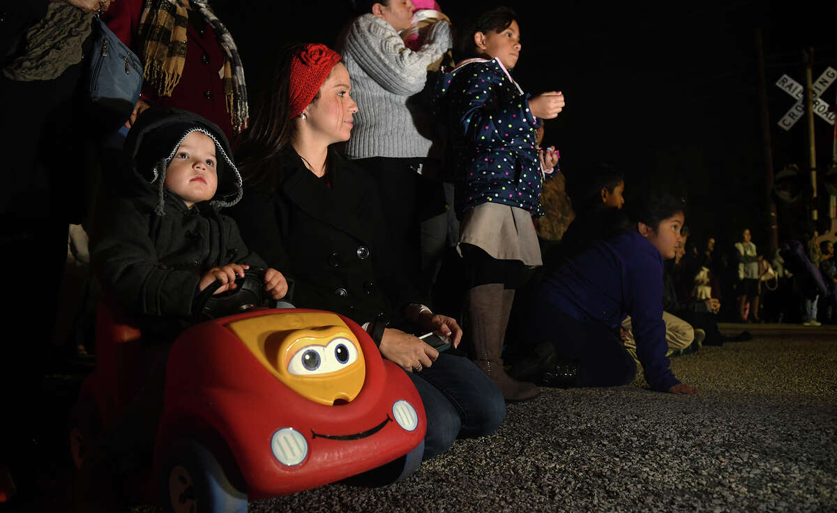 Lofton Martin, 2, left, with his mom Crystal, of Humble, takes in the sights and sounds of the 26th Annual Christmas Parade of Lights on historic Main Street in Humble on Dec. 5, 2017. This year's parade theme was