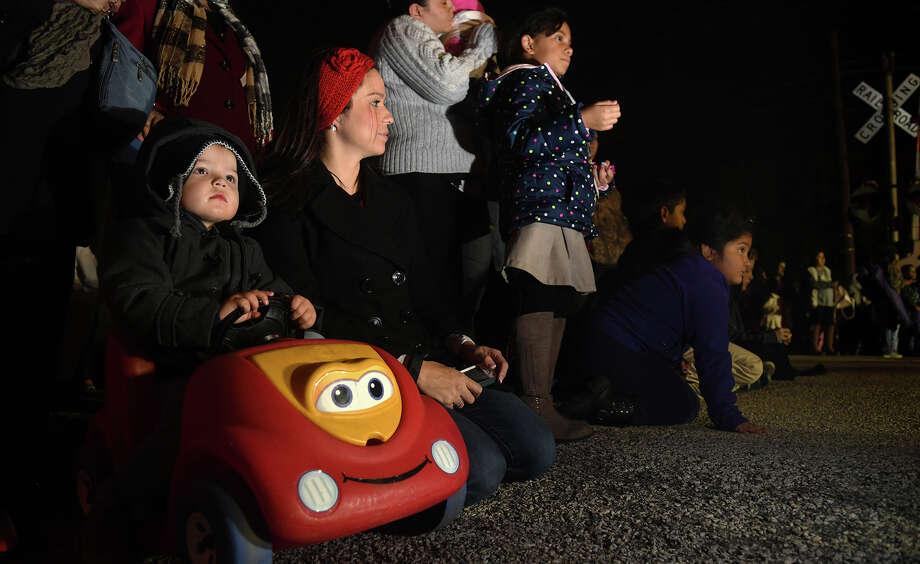 """Lofton Martin, 2, left, with his mom Crystal, of Humble, takes in the sights and sounds of the 26th Annual Christmas Parade of Lights on historic Main Street in Humble on Dec. 5, 2017. This year's parade theme was """"A Star Spangled Christmas"""". (Photo by Jerry Baker/Freelance) Photo: Jerry Baker, Freelance / Freelance"""