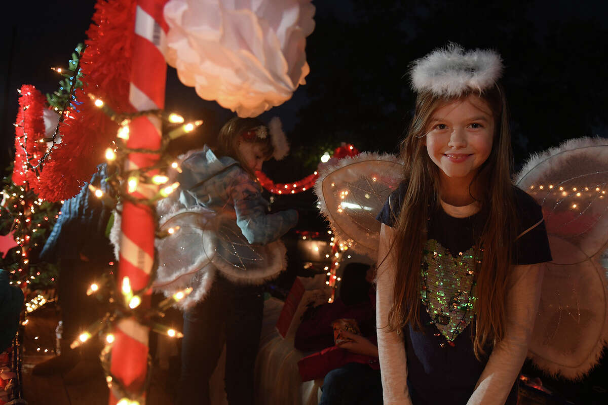 Gracie Carey, 10, a 4th grader at Fall Creek Elem. and member of the school's Girl Scout Troop 118004, shows off her angel halo and wings before riding her troop's float in the 26th Annual Christmas Parade of Lights on historic Main Street in Humble on Dec. 5, 2017. This year's parade theme was