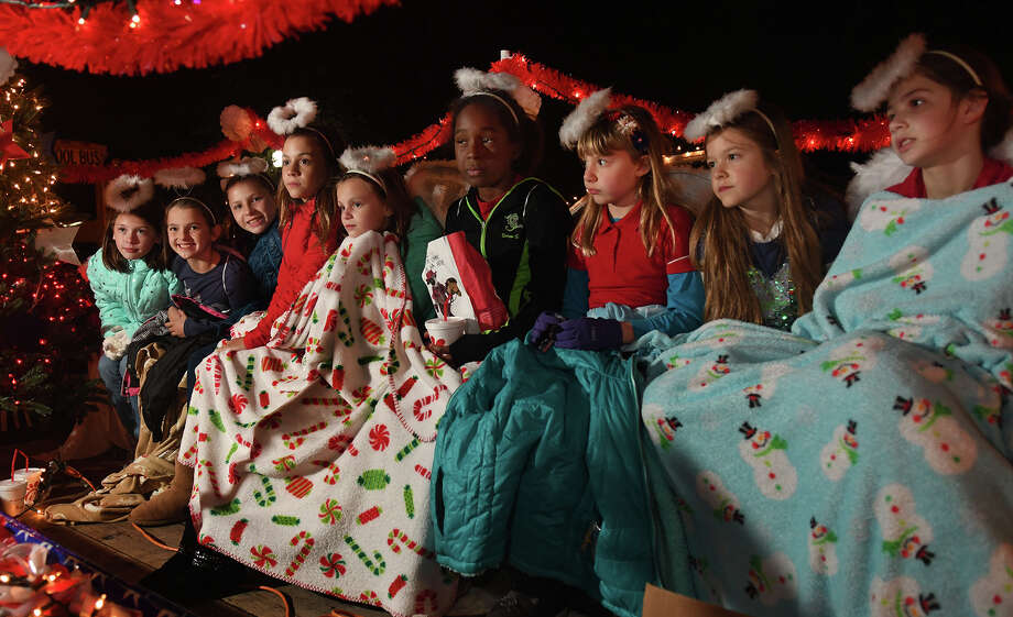 """Katie Marcontell, 10, from right, Gracie Carey, 10, Maddie Hedge, 9, Soren Sloan, 10, Elise Martin, 10, Lexi Kamauf, 10, Julia Martin, 9, and Reese Shevehek, 10, and Keri Ovalle, 9, all Fall Creek Elem. Girl Scout Troop 118004 members, get some last-minute instructions from troop leader Laura Hedge as they wait on their float for the start of the 26th Annual Christmas Parade of Lights on historic Main Street in Humble on Dec. 5, 2017. This year's parade theme was """"A Star Spangled Christmas"""". (Photo by Jerry Baker/Freelance) Photo: Jerry Baker, Freelance / Freelance"""