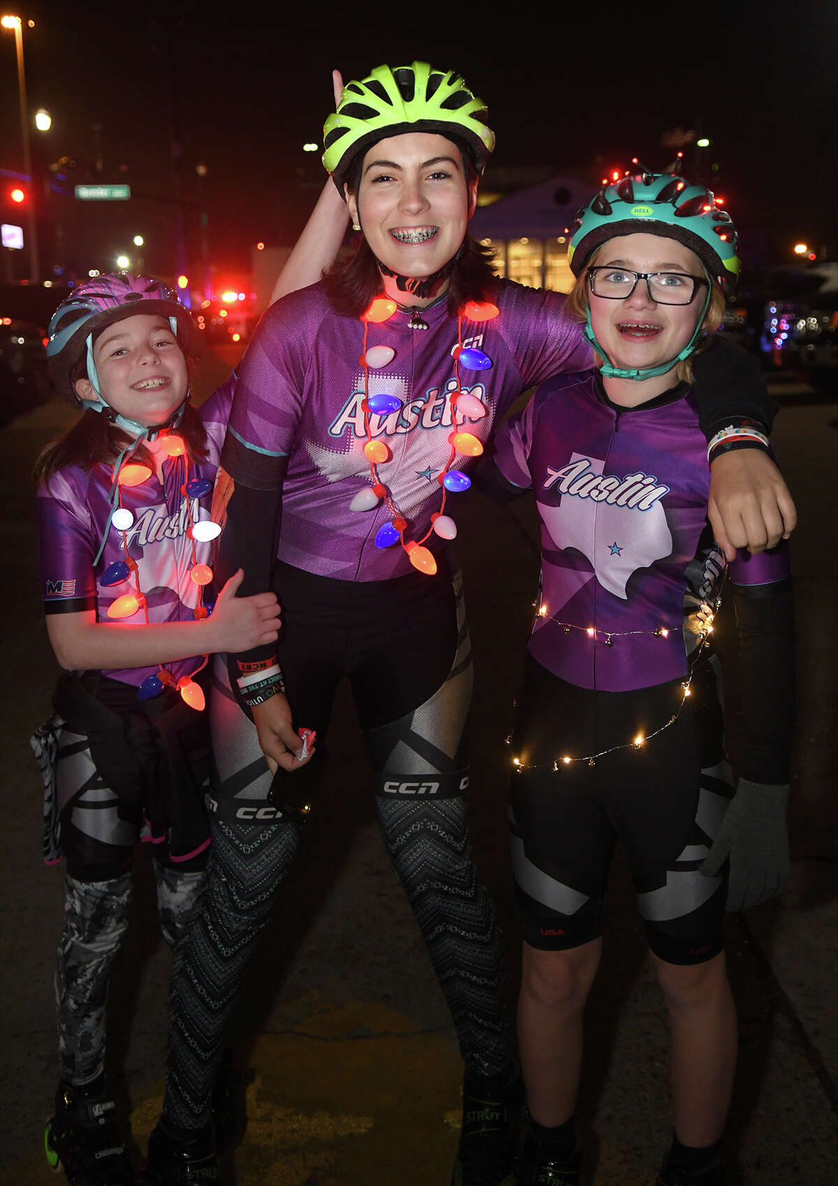 Hailey Sharp, 10, from left, a 4th grader at Greentree Elem., Joslin Ingraham, 14, an 8th grader at Creekwood Middle School, and Ayla Lydick, 11, a 6th grader at Creekwood Middle School, all members of the Texas Speed Club of inline skaters, wait for the start of the 26th Annual Christmas Parade of Lights on historic Main Street in Humble on Dec. 5, 2017. This year's parade theme was