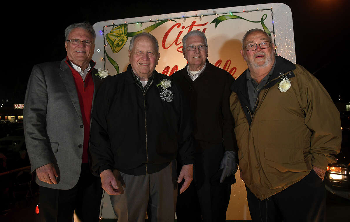 Humble City Council members Norman Funderburk, from left, Ray Calfee, Alan Steagall and Charles Curry wait on their float for the start of the 26th Annual Christmas Parade of Lights on historic Main Street in Humble on Dec. 5, 2017. This year's parade theme was