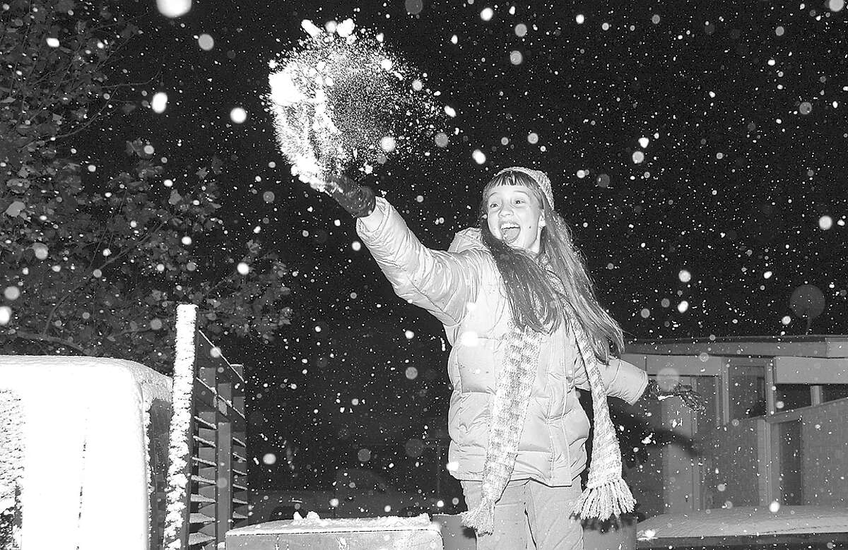 In this file photo from 2004, a Laredoan is seen reacting to the snowfall.