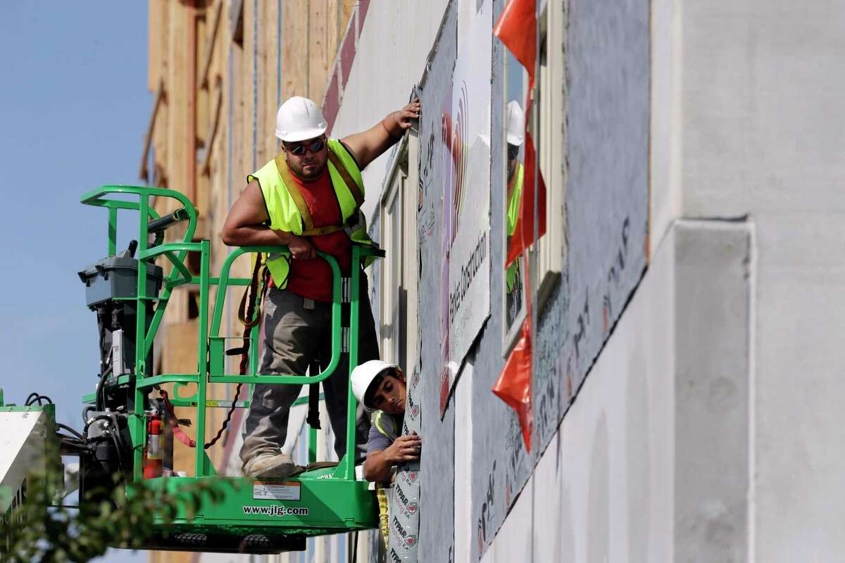 Workers build an apartment and retail complex in Nashville this fall. The Labor Department said Wednesday that worker productivity has increased.