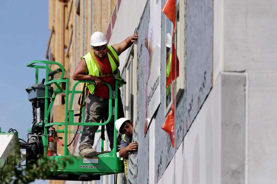 Workers build an apartment and retail complex in Nashville this fall. The Labor Department said Wednesday that worker productivity has increased.  Photo: Mark Humphrey, STF / Copyright 2017 The Associated Press. All rights reserved.