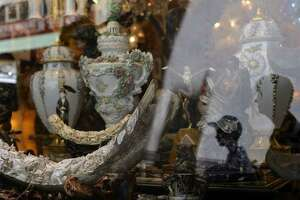 """In this Chronicle file photo from July 28, 2015, people pass by a piece described as a """"mammoth ivory tusk"""" in a shop window in San Francisco's Chinatown."""