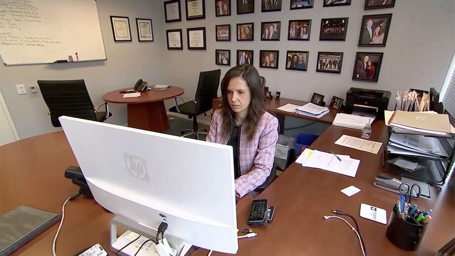 In this Dec. 4, 2017, image made from a video, Eleanor McManus works at her desk at Trident DMG, the Washington public relations firm she co-founded. McManus formed a support group for women like her who say they were victimized by powerful men in the television news business and is the co-founder of Press Forward, an initative aimed at changing newsroom culture. (AP Photo/Dan Huff) Photo: Dan Huff, STF / ap