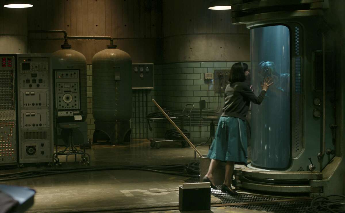 """This image released by Fox Searchlight Pictures shows Sally Hawkins and Doug Jones in a scene from the film """"The Shape of Water."""" (Fox Searchlight Pictures via AP)"""