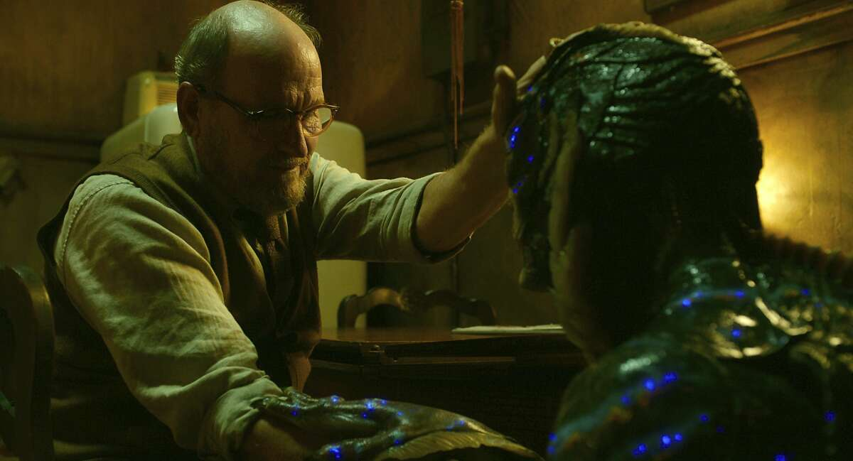 """This image released by Fox Searchlight Pictures shows Richard Jenkins, left, and Doug Jones in a scene from the film """"The Shape of Water."""" (Fox Searchlight Pictures via AP)"""
