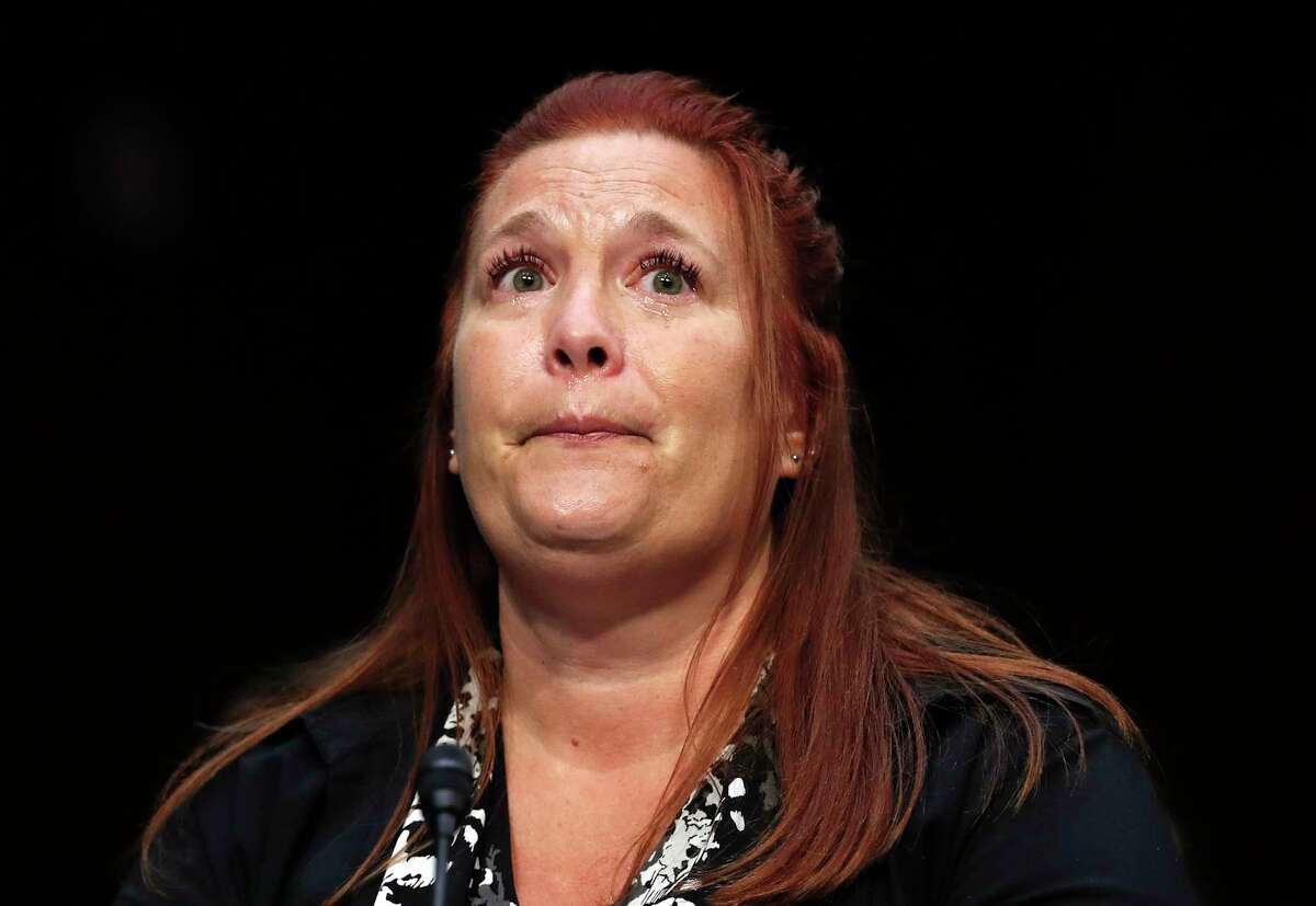 Heather Gooze, Las Vegas shooting witness, cries as she testifies during a Senate Judiciary Committee hearing on Capitol Hill in Washington, Wednesday, Dec. 6, 2017, entitled: