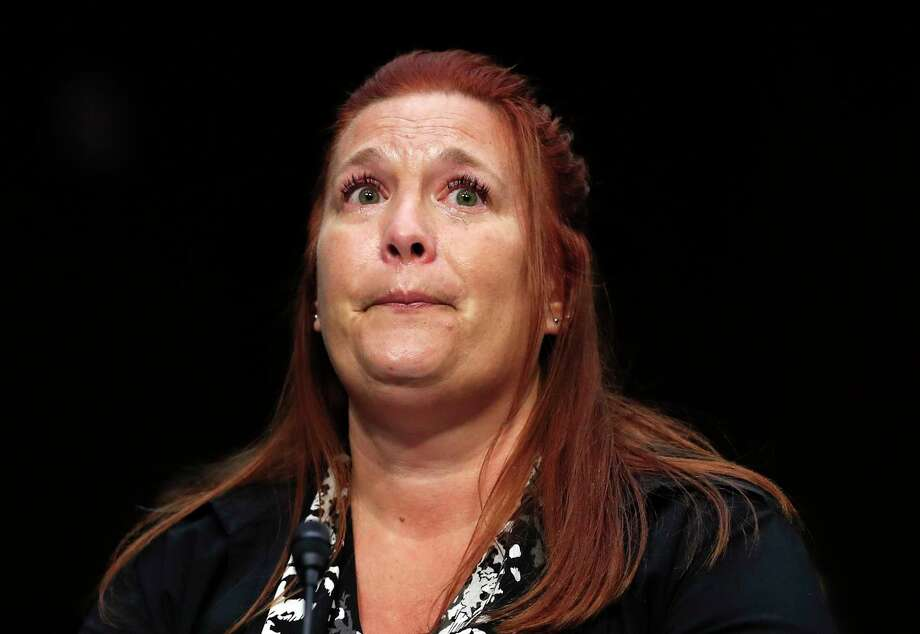 "Heather Gooze, Las Vegas shooting witness, cries as she testifies during a Senate Judiciary Committee hearing on Capitol Hill in Washington, Wednesday, Dec. 6, 2017, entitled: ""Firearm Accessory Regulation and Enforcing Federal and State Reporting to the National Instant Criminal Background Check System (NICS)."" (AP Photo/Carolyn Kaster) Photo: Carolyn Kaster, STF / Copyright 2017 The Associated Press. All rights reserved."