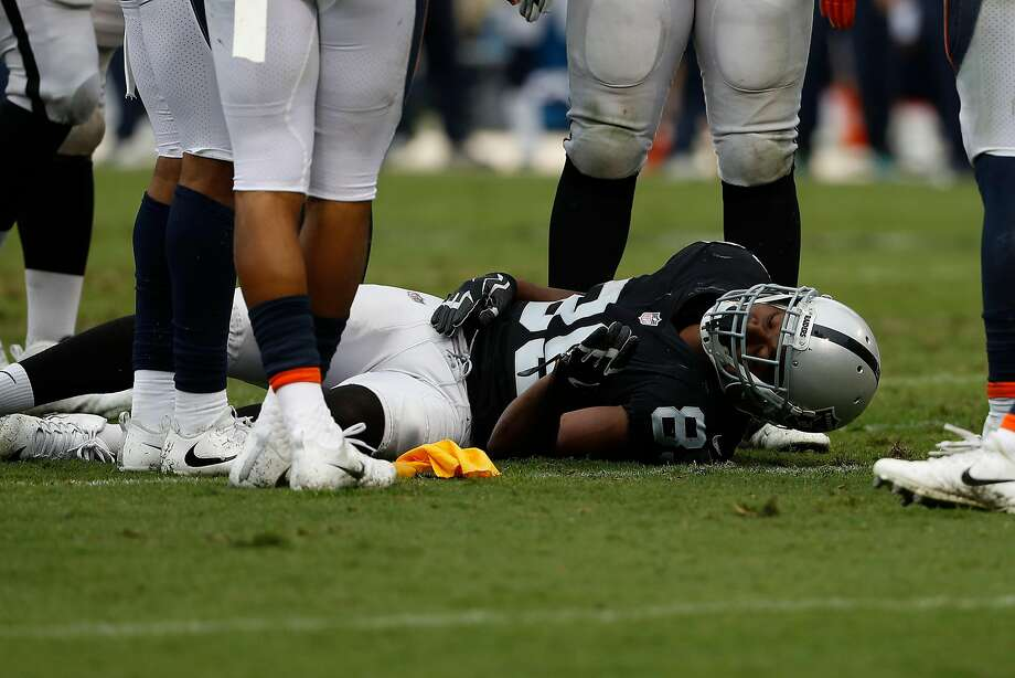 OAKLAND, CA - NOVEMBER 26: Amari Cooper #89 of the Oakland Raiders is seen on the field after he was injured during the second quarter of his NFL football game against the Denver Broncos at Oakland-Alameda County Coliseum on November 26, 2017 in Oakland, California. (Photo by Stephen Lam/Getty Images) Photo: Stephen Lam, Getty Images
