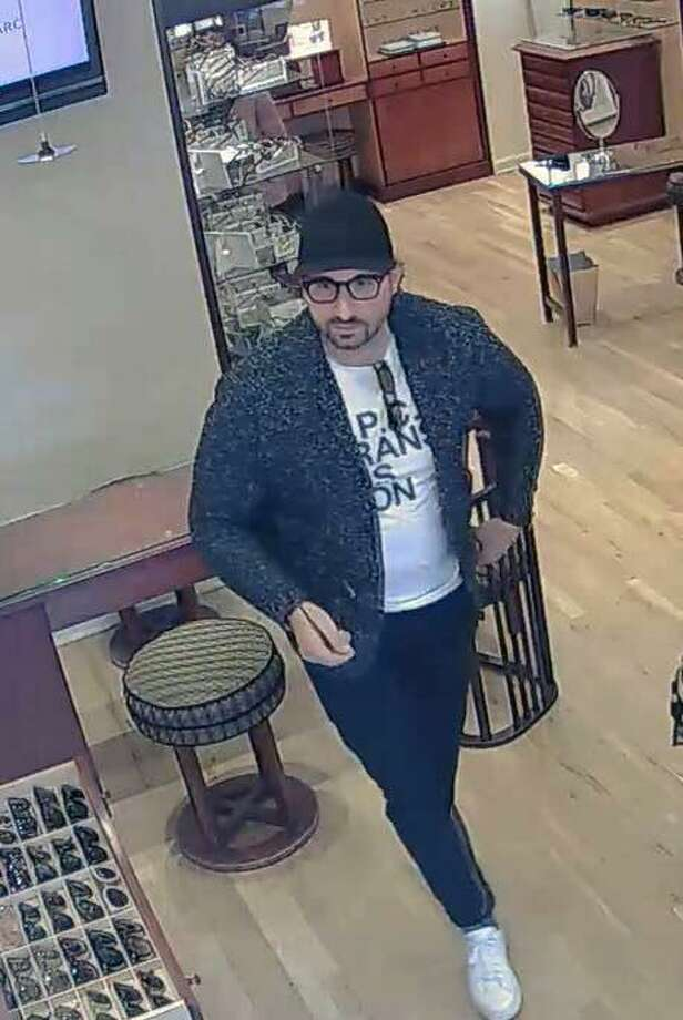 The man — who police said is suspected of a larceny on Nov. 29, 2017 — is described as a white male in his late-30s or early-40s. Westport, Conn., police said he has black, collar-length hair and a goatee. Photo: Contributed Photo / Westport Police Department / Contributed Photo / Connecticut Post Contributed