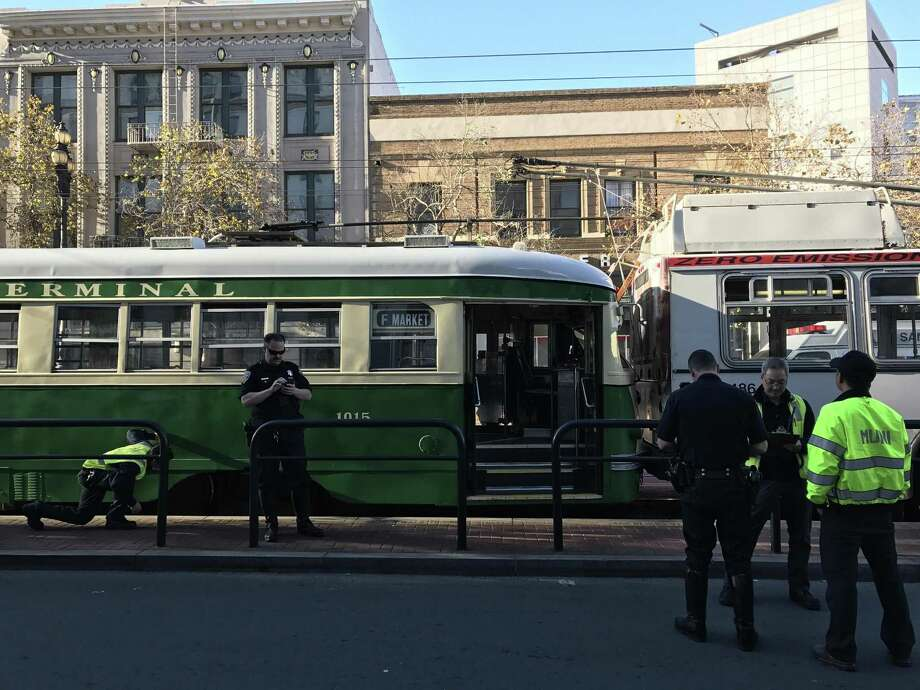 A historic street car crashed into the rear of a Muni bus on Market Street in San Francisco Wednesday injuring nine passengers. Photo: Sarah Ravani The Chronicle / /