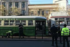 A historic street car crashed into the rear of a Muni bus on Market Street in San Francisco Wednesday injuring nine passengers.
