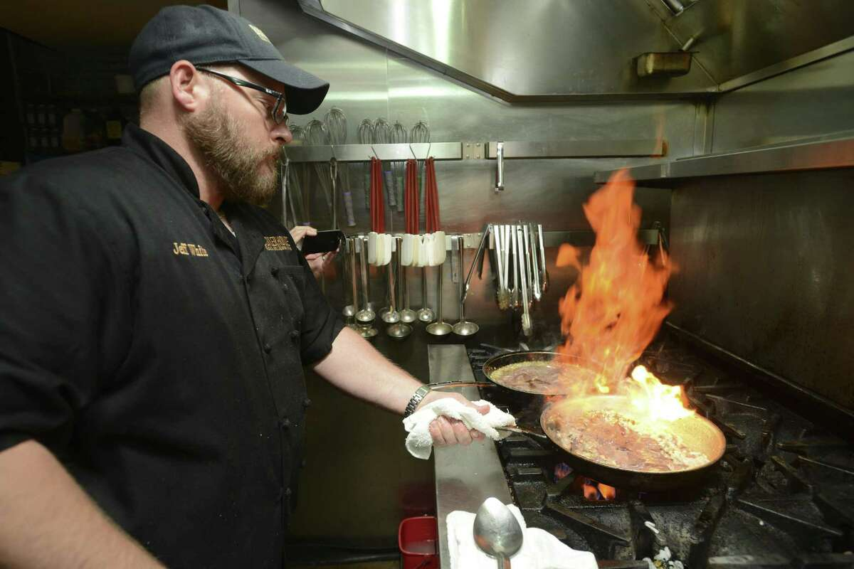 Chef Jeff White of Boiler House cooks chicken livers with caramelized onions to make pate inside the kitchen of the Boiler House. White will be the featured chef at an upcoming Saint City Super Club event in January.