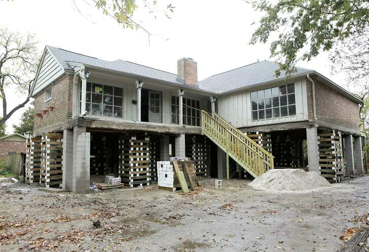 A home on Braesvalley Drive in the Meyerland neighborhood is in the process of being raised by Arkitekture Development photographed on Wednesday, Dec. 6, 2017, in Houston. ( Elizabeth Conley / Houston Chronicle )