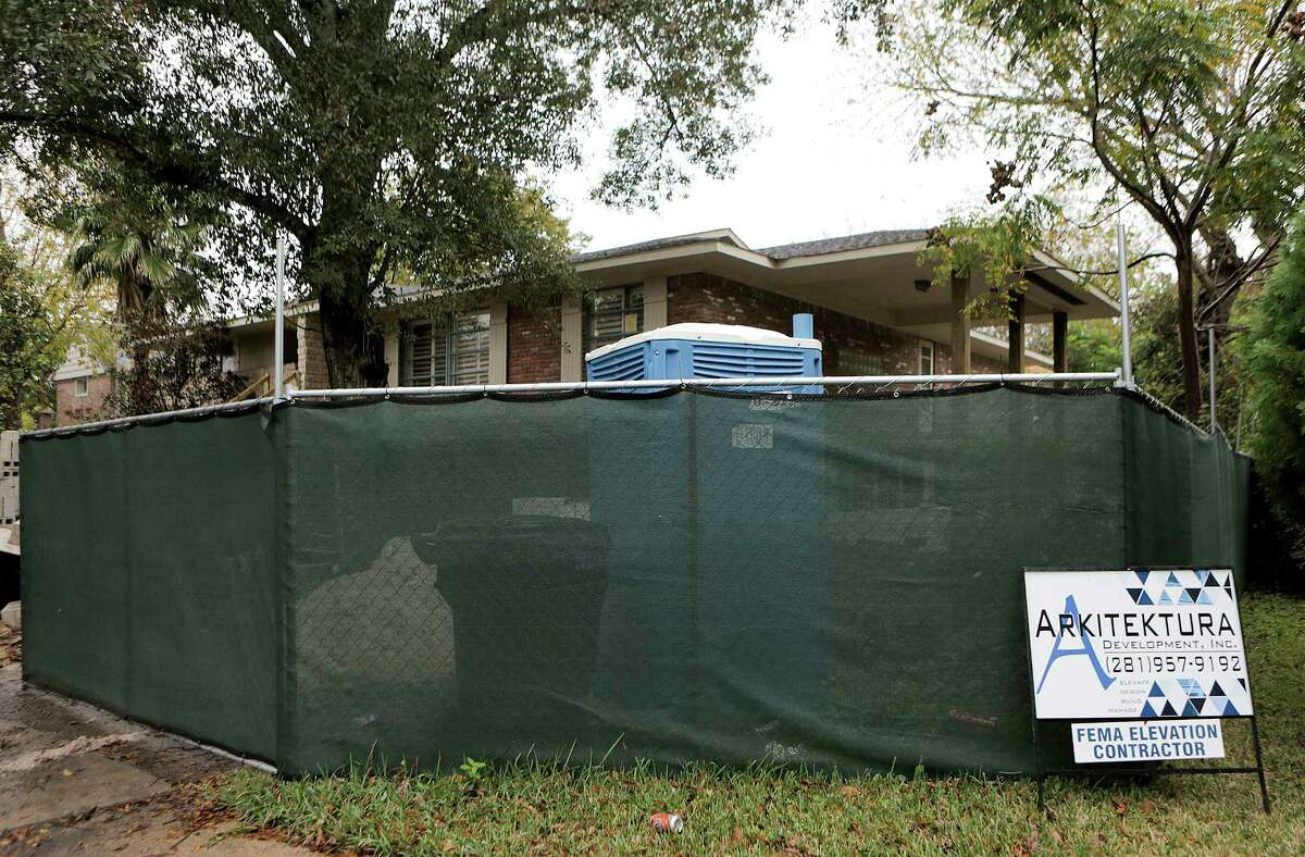 A home on glenmeadow in the Meyerland neighborhood is in the process of being raised by Arkitekture Development following Harvey, photographed on Wednesday, Dec. 6, 2017, in Houston. ( Elizabeth Conley / Houston Chronicle )