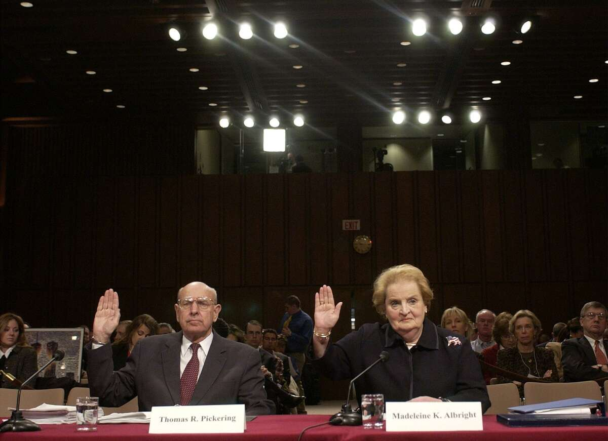 Former Secretary of State Madeleine Albright, right, and former U.S. Ambassador Thomas Pickering, left, are sworn in before the federal panel reviewing the Sept. 11 attacks Washington Tuesday, March 23, 2004. (AP Photo/Gerald Herbert)