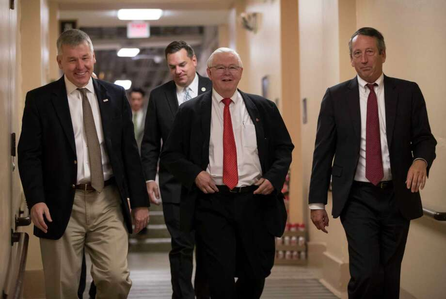 House Republicans, from left, Rep. Rob Woodall, R-Ga., Rep. Richard Hudson, R-N.C., Rep. Joe Barton, R-Texas, and Rep. Mark Sanford, R-S.C., arrive for a closed-door strategy session last week on Capitol Hill.  Photo: J. Scott Applewhite, STF / Copyright 2017 The Associated Press. All rights reserved.