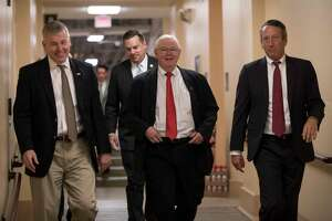 House Republicans, from left, Rep. Rob Woodall, R-Ga., Rep. Richard Hudson, R-N.C., Rep. Joe Barton, R-Texas, and Rep. Mark Sanford, R-S.C., arrive for a closed-door strategy session last week on Capitol Hill.