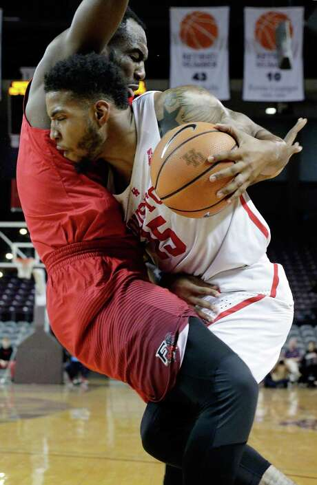 UH forward Devin Davis, right, runs out of operating room while trying to drive on Fairfield's Jonathan Kasibabu during the first half Wednesday. Photo: Michael Wyke, Freelance / © 2017 Houston Chronicle