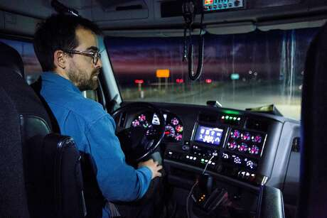 Brett Goodroad drives on Saturday, Nov. 25, 2017, in Firebaugh, Calif. Goodroad drives for Veritable Vegetable and will make many deliveries on his way to New Mexico and back.