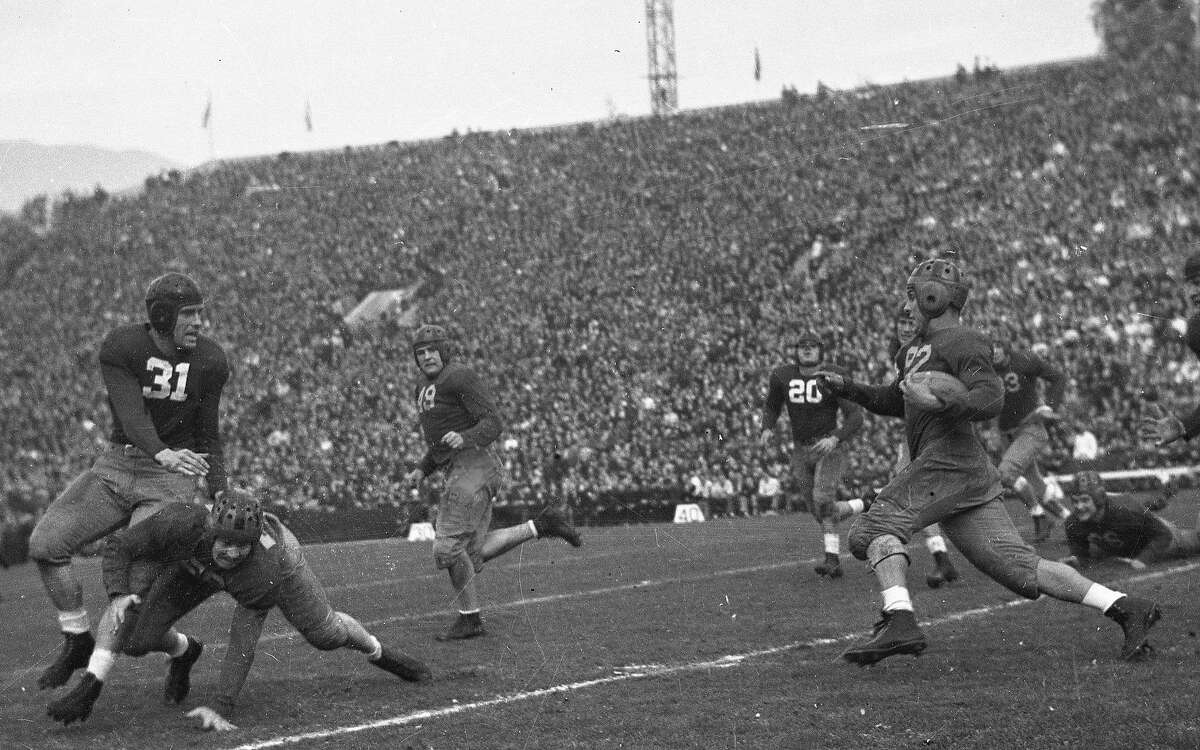 Cal Bears beats Alabama in the Rose Bowl, January 1, 1938 Here Vic Bottari (92) breaks into the open as Dave Anderson (56) and Johnny Meek (49) lead the way.
