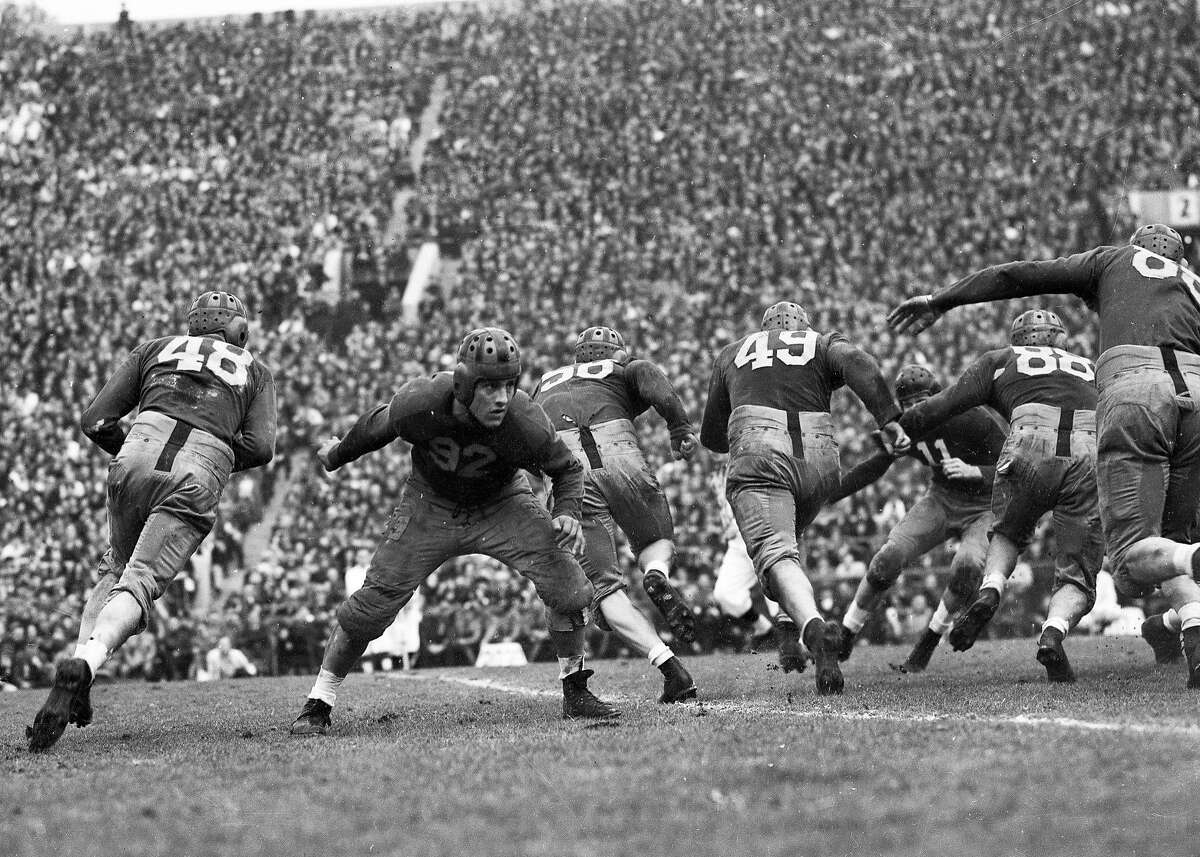 Cal Bears beats Alabama in the Rose Bowl, January 1, 1938 Here Henry Sparks blocks as Sam Chapman(48) runs behind Dave Anderson (56) and Johnny Meek (49)
