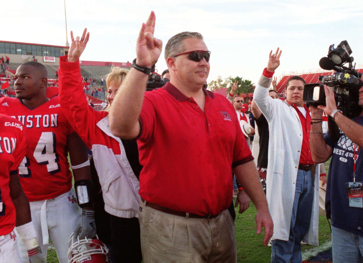 University of Houston coach Dana Dimel celebrates UH's win over Louisville. This is Dimel's last game coaching the Cougars. Photo by Steve Campbell, Houston Chronicle 11/30/02