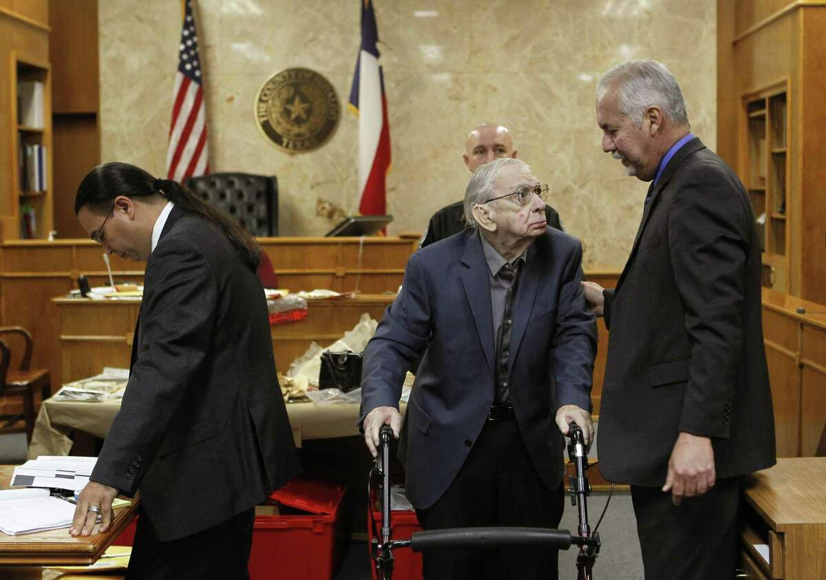 John Bernard Feit talks with his defense attorney A. Ricardo Flores, right, as fellow defense attorney O. Rene Flores, left, looks over papers during a break in Feit's trial for the 1960 murder of Irene Garza Wednesday, December 6, 2017, at the Hidalgo County Courthouse in Edinburg. (Nathan Lambrecht/The Monitor/Pool)