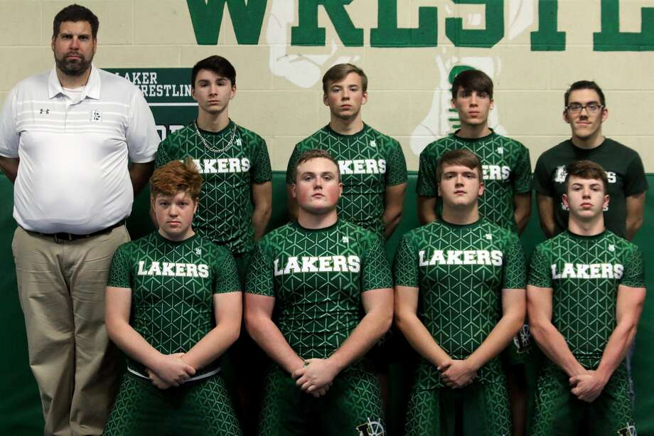 Members of the EPBP wrestling team are (front row from left) Kelly Rice, Blake Smithers, Christopher Potter and Gage Brownell (back row) coach Steve McIntosh, Juan Quintana, Brent Krzeszewski, James Rochon and assistant coach Andrew Rochon. Photo: Thumb Sportswriters Association