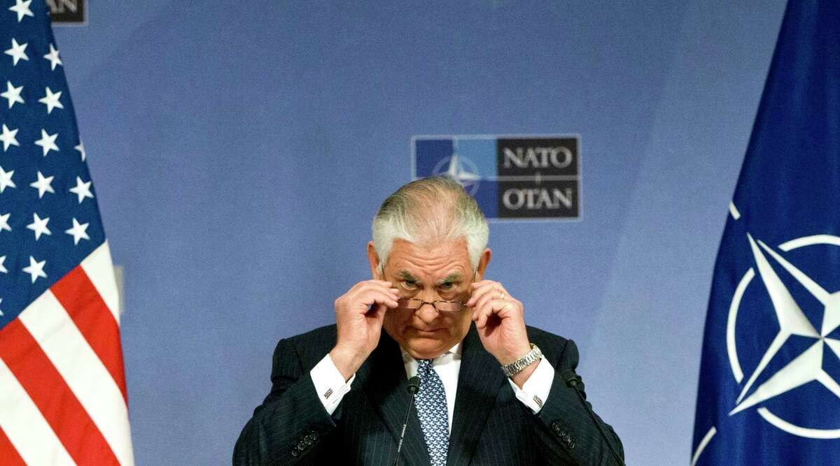 U.S. Secretary of State Rex Tillerson adjusts his glasses as he speaks during a media conference at NATO headquarters in Brussels on Wednesday, Dec. 6, 2017. U.S. Secretary of State Rex Tillerson and his NATO counterparts held talks on Georgia and counter-terrorism efforts on Wednesday, the final day of their two-day meeting in Brussels.(AP Photo/Virginia Mayo)