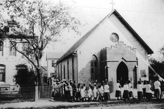 The St. Peter Claver School opened in 1888. This historic photo shows the school in 1903.