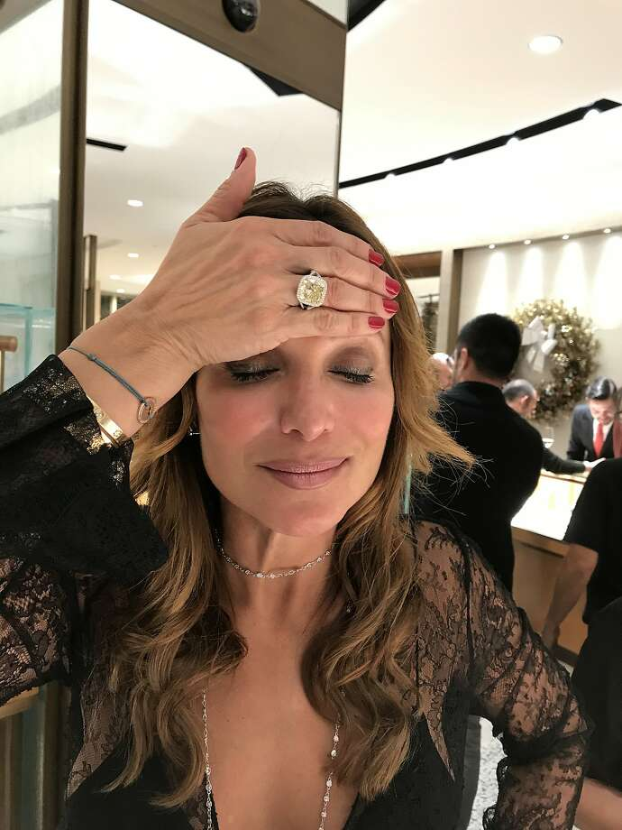 The ring that people couldn't stop trying on: Claudia Ross makes a wish about the $199,000 yellow diamond by Harry Kotlar at Shreve & Co. Photo: Carolyne Zinko, San Francisco Chronicle