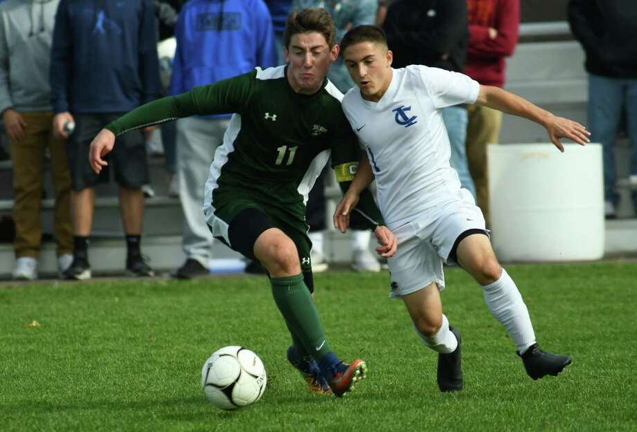 Sahalmont's Alex Diana and Ichabod's Anthony Carlucci pursue the ball during the Class B boys soccer section II final on Saturday in Colonie. (Jenn March/Special to the Times Union) Photo: Jenn March / 20041920A