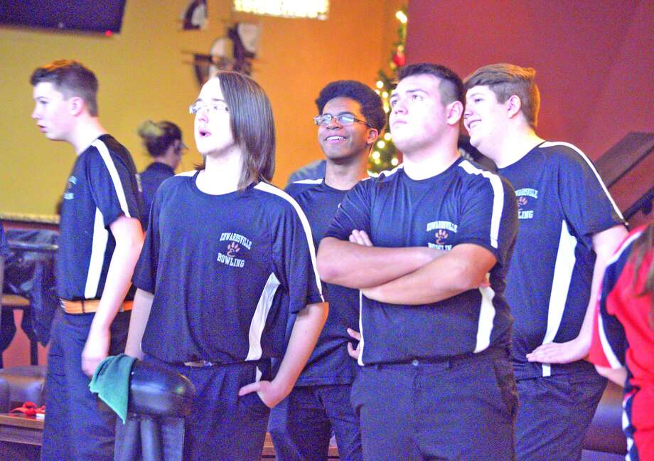 The EHS boys' bowling team watches the scoreboard.